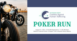 Two motorcycles parked on the left side. On the right is the logo for the Medina County Coaliltion Against Human Trafficking and the information for the Poker Run